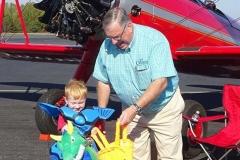 Ken-with-Kid-in-front-of-Stearman.-766